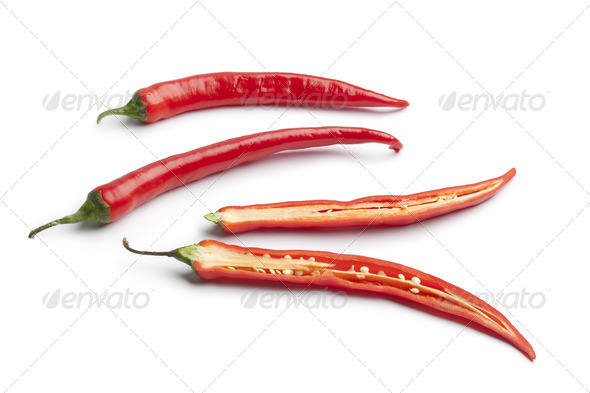 Whole and half fresh red pepper - Stock Photo - Images