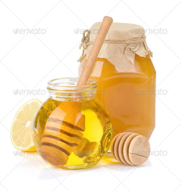 glass jar full of honey and lemon - Stock Photo - Images