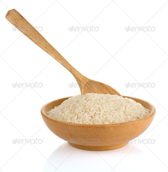 rice in wooden plate and spoon - Stock Photo - Images