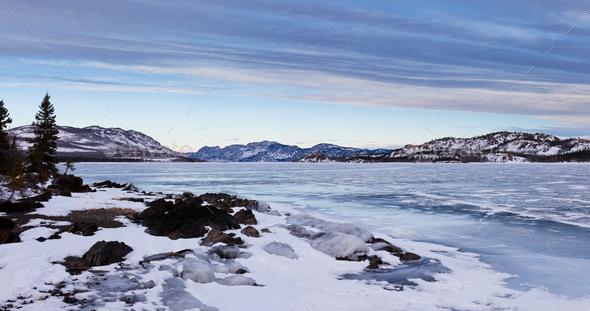 Panorama of frozen Lake Laberge Yukon T Canada - Stock Photo - Images
