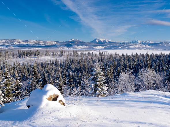 Scenic winter at frozen Lake Laberge Yukon Canada - Stock Photo - Images