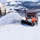 Snow plough clearing road in winter storm blizzard - PhotoDune Item for Sale