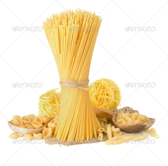pasta and wooden spoon on white - Stock Photo - Images