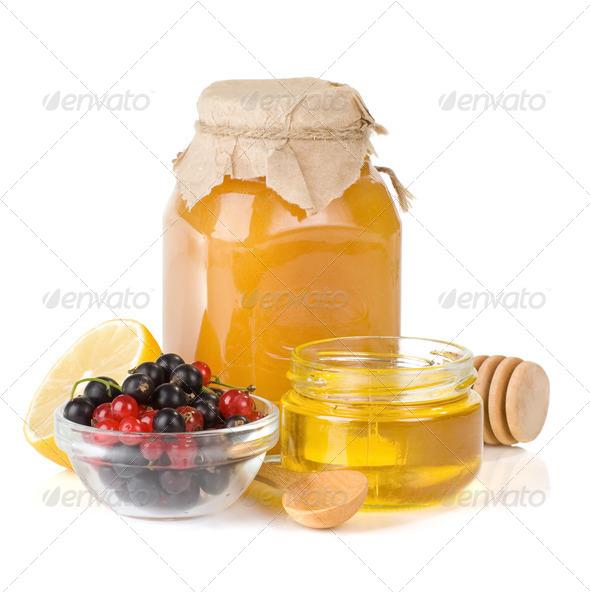 glass jar full of honey, lemon and berry - Stock Photo - Images