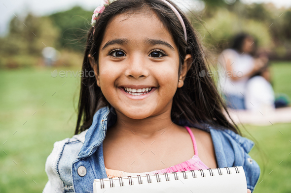 Portrait of indian female kid at city park - Stock Photo - Images