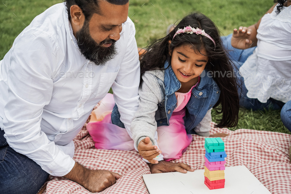 Happy indian father and daughter having fun playing outdoor at city park - Stock Photo - Images