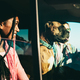 Happy young friends having fun in camper van with pet dog during summer vacation - PhotoDune Item for Sale