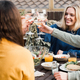 Young multiracial people cheering with wine and eating outdoors at patio restaurant - PhotoDune Item for Sale