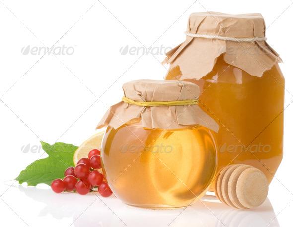 jar of honey and fruit isolated on white - Stock Photo - Images
