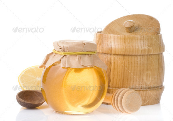 honey in jar isolated on white - Stock Photo - Images