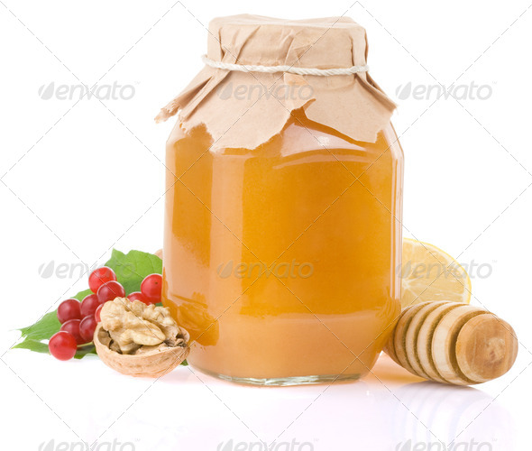 glass jar full of honey and fruit - Stock Photo - Images