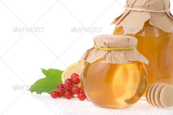 glass jar full of honey on white - Stock Photo - Images