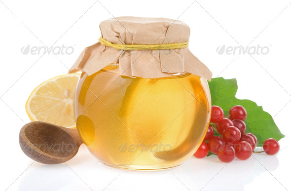 jar of honey and fruit isolated - Stock Photo - Images