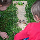 Toddlers observing snails in a play - PhotoDune Item for Sale