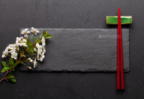 Japanese food with cherry blossom and sushi chopsticks - Stock Photo - Images