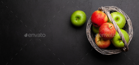 Fresh ripe apples in basket - Stock Photo - Images