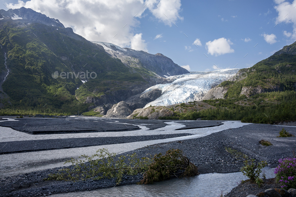 Exit Glacier and mountains near Seward Alaska on a sunny afternoon - Stock Photo - Images
