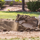 Small Bulldozer Digging In Yard For Pool Installation - PhotoDune Item for Sale