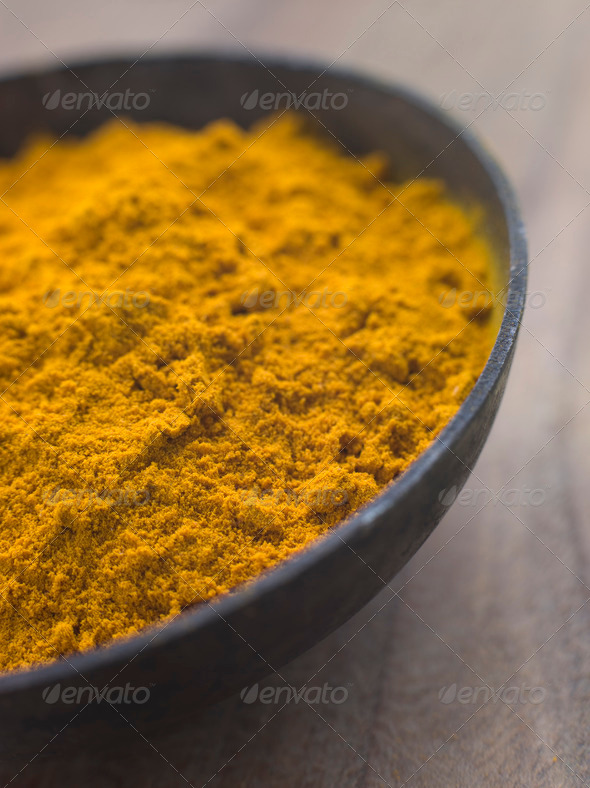 Dish of Ground Dried Turmeric - Stock Photo - Images