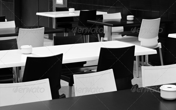 Street small cafe with bw tables and chairs. - Stock Photo - Images