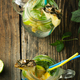 Lemonade with lime mint and pineapple on wooden background - PhotoDune Item for Sale