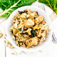 Funchoza with chard and meat in bowl on light board top - PhotoDune Item for Sale
