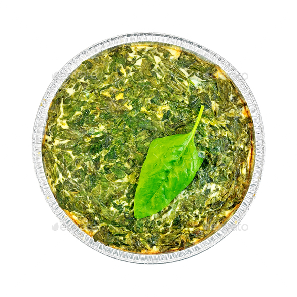 Pie celtic with spinach leaves in form of foil - Stock Photo - Images