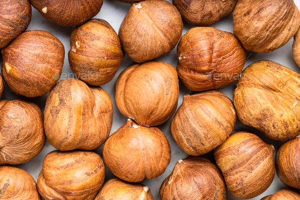 background - many ripe shelled hazelnuts - Stock Photo - Images
