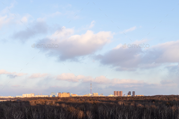 sunset sky over city park and residential district - Stock Photo - Images