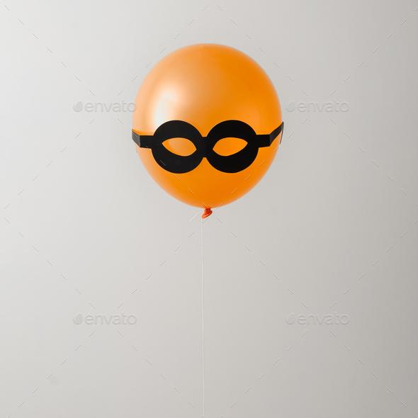 Balloon orange and black glasses. Party or hidden criminal concept. Minimal idea. - Stock Photo - Images
