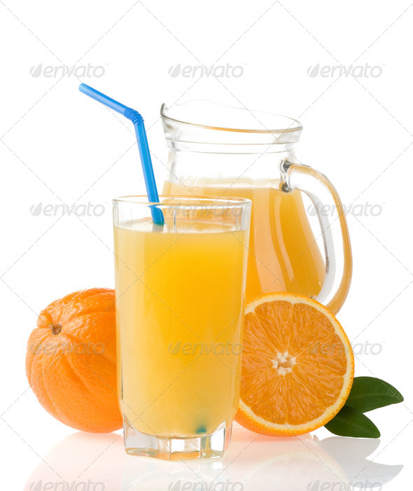 orange juice in glass and slices on white - Stock Photo - Images