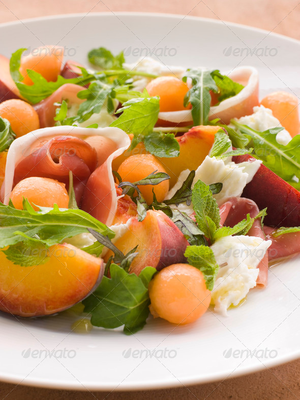 Platter of Cantaloupe Melon Parma Ham Mozzarella Cheese and Peach - Stock Photo - Images