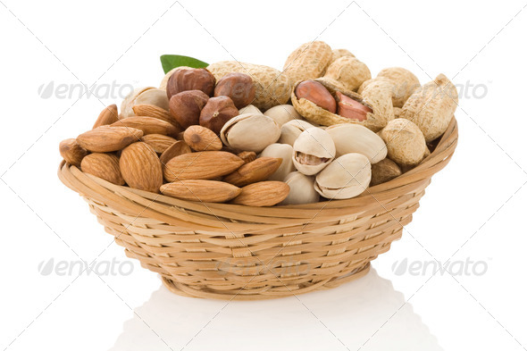 set of nuts in bowl isolated on white - Stock Photo - Images