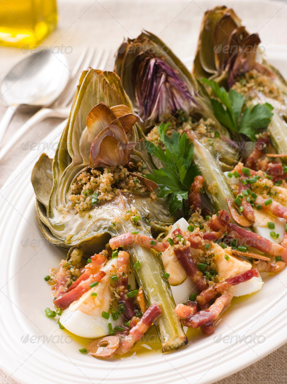 Roasted Globe Artichokes with Pancetta Egg and Garlic Breadcrumbs - Stock Photo - Images