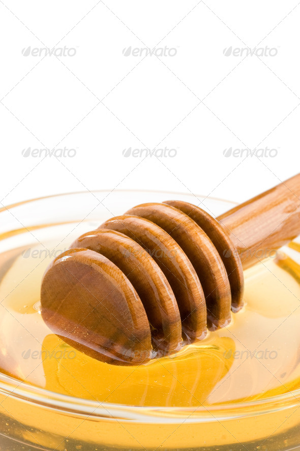honey in glass and stick isolated on white - Stock Photo - Images
