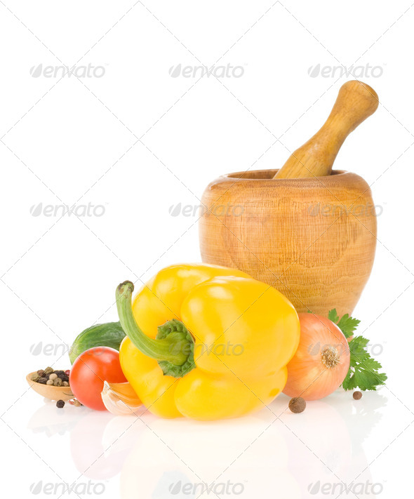 mortar with pestle and spices vegetable isolated on white - Stock Photo - Images