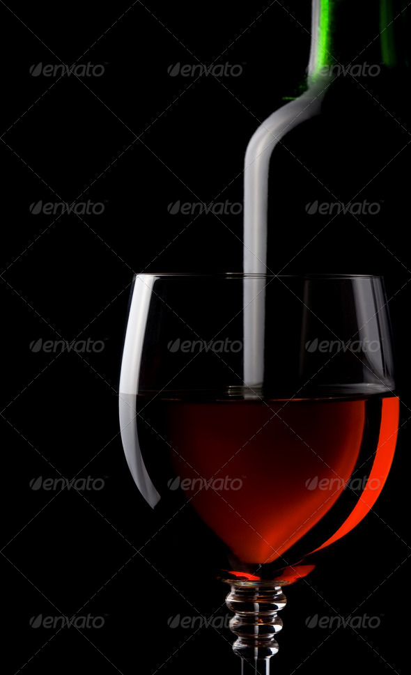 wine in glass and bottle isolated on black - Stock Photo - Images