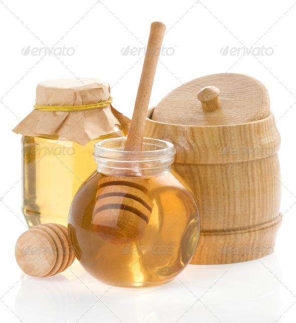 jar of honey and wood stick on white - Stock Photo - Images