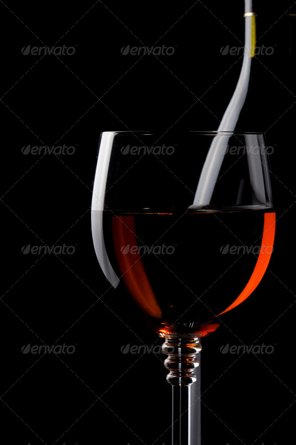 wine in glass and bottle on black - Stock Photo - Images