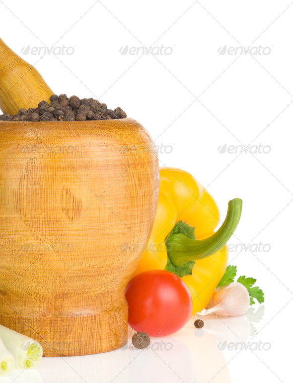 mortar with pestle and spices vegetable on white - Stock Photo - Images