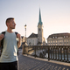 Man walking against cityscape of old town at sunset - PhotoDune Item for Sale