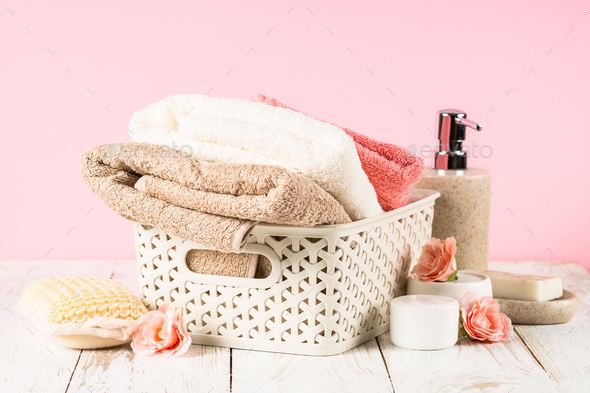 Bathroom background with towels, soapand cosmetics bottle at the table - Stock Photo - Images