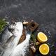 Fresh fish dorado on black stone table - PhotoDune Item for Sale
