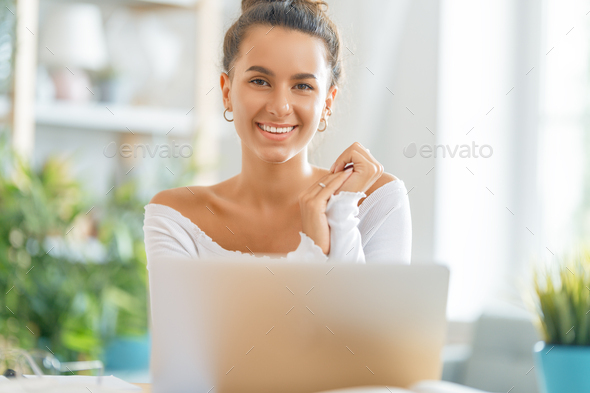 woman working on laptop at home - Stock Photo - Images