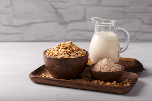 Non dairy oat milk and flakes - Stock Photo - Images