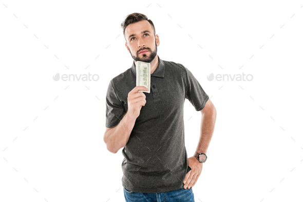 portrait of pensive man with dollar banknote in hand isolated on white - Stock Photo - Images