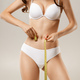 Woman with natural slim tanned body in underwear - PhotoDune Item for Sale