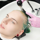 Head of Young Woman in Sink. Hairdresser Washing Green Hair of Customer with Shampoo Using Shower - PhotoDune Item for Sale