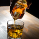 Pouring whisky into a glass - PhotoDune Item for Sale