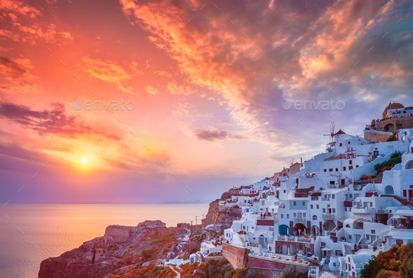 Sunset over Oia town on Santorini island in summer. Santorini, Greece - Stock Photo - Images